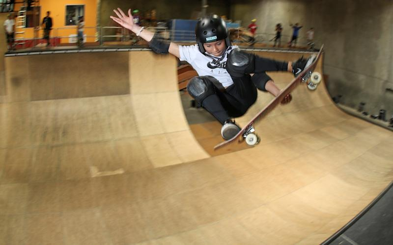 Professional skateboarder and British Olympic athlete Sky Brown gets some air while riding Tony Hawk's office ramp - REUTERS