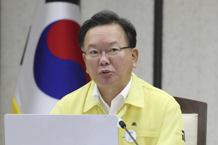 """South Korean Prime Minister Kim Boo-kyum speaks during a meeting of the Central Disaster and Safety Countermeasures Headquarters at the government complex in Sejong, South Korea, Tuesday, July 20, 2021. Kim on Tuesday apologized for """"failing to carefully take care of the health"""" of hundreds of sailors who contracted the coronavirus on a navy ship taking part in an anti-piracy mission off East Africa. (Kim Ju-hyung/Yonhap via AP)"""