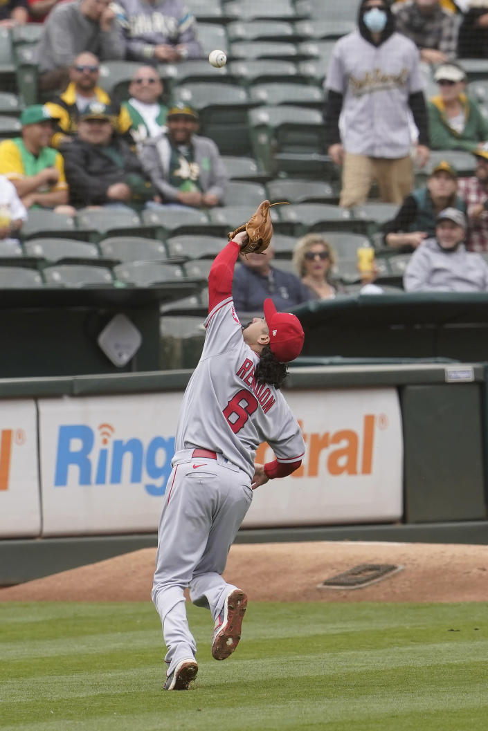 Los Angeles Angels third baseman Anthony Rendon catches a foulout hit by Oakland Athletics' Matt Olson before doubling up Tony Kemp during the fourth inning of a baseball game in Oakland, Calif., Saturday, May 29, 2021. (AP Photo/Jeff Chiu)