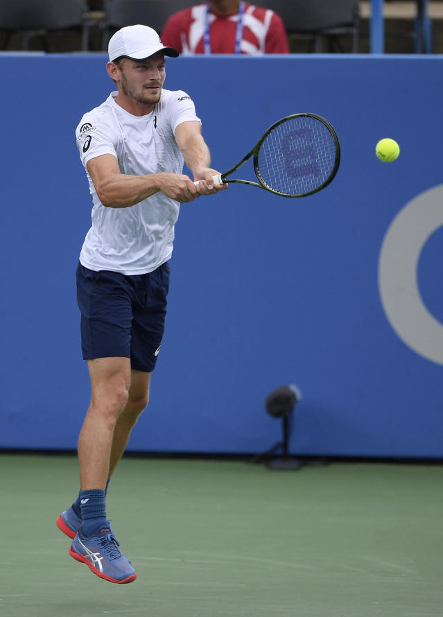 David Goffin, of Belgium, returns a shot against Stefanos Tsitsipas, of Greece, during the Citi Open tennis tournament, Friday, Aug. 3, 2018, in Washington. (AP Photo/Nick Wass)