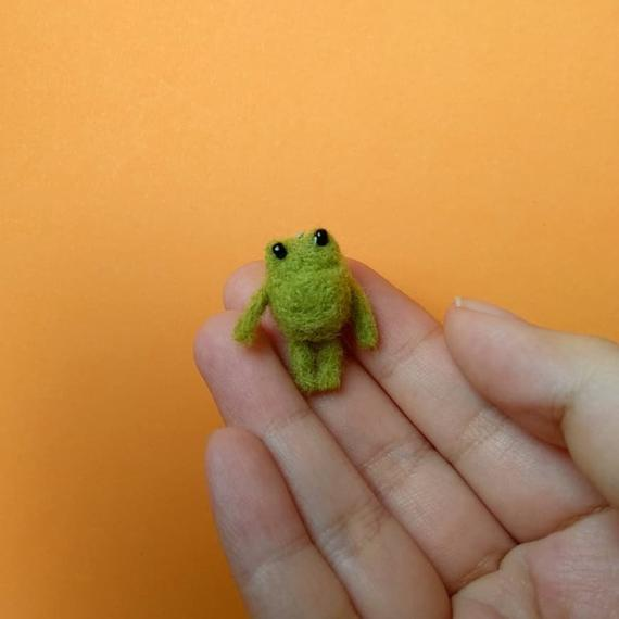 "<h2>Needle Felted Frog<br></h2>The best thing about this ribbit bb, aside from everything, is that you can ask its felt maker to customize it as a bookmark, phone charm, or dust plug. <br><br><strong>VerminPlanet</strong> Needle Felted Frog, $, available at <a href=""https://go.skimresources.com/?id=30283X879131&url=https%3A%2F%2Fwww.etsy.com%2Flisting%2F712624285%2Fneedle-felted-miniature-green-frog-soft"" rel=""nofollow noopener"" target=""_blank"" data-ylk=""slk:Etsy"" class=""link rapid-noclick-resp"">Etsy</a>"