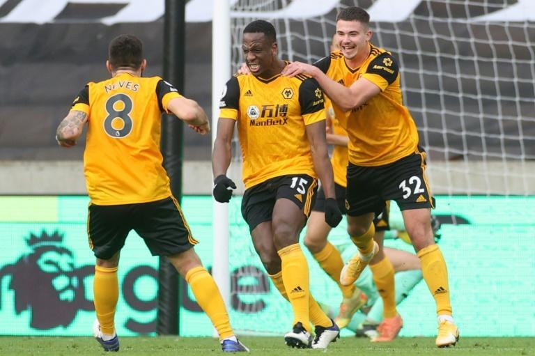 Ivory Coast international Willy Boly (C) celebrates scoring for Wolves against West Bromwich in the English Premier League.