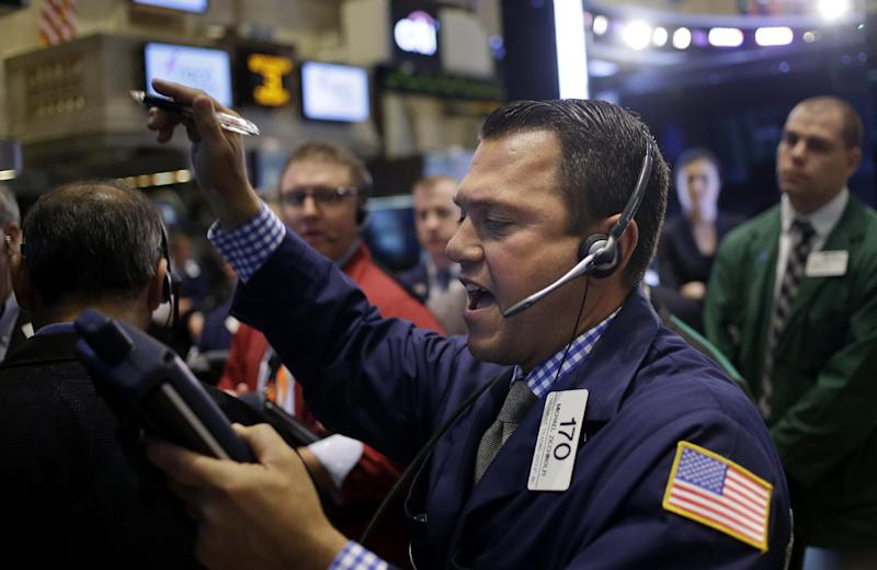 Traders work on the floor at the New York Stock Exchange in New York, Tuesday, Sept. 3, 2013. The stock market started September with a rally Tuesday as worries of an imminent U.S. attack on Syria faded. (AP Photo/Seth Wenig)