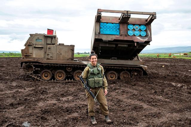 <p>Israeli army sergeant Amit Malekin, 19, commander of a mobile rocket launcher, poses for a picture in the Israeli-annexed Golan Heights near the border between Israel and Syria on February 26, 2018. (Photo: Jack Guez/AFP/Getty Images) </p>