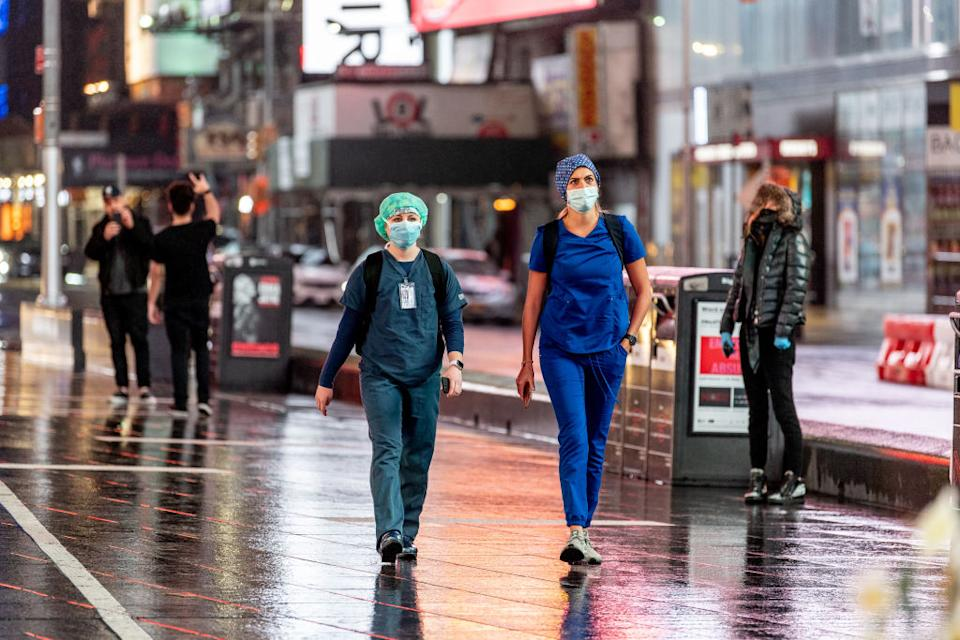 Medical workers wear masks in Times Square during the the COVID-19 shutdown on April 26. Source: Getty