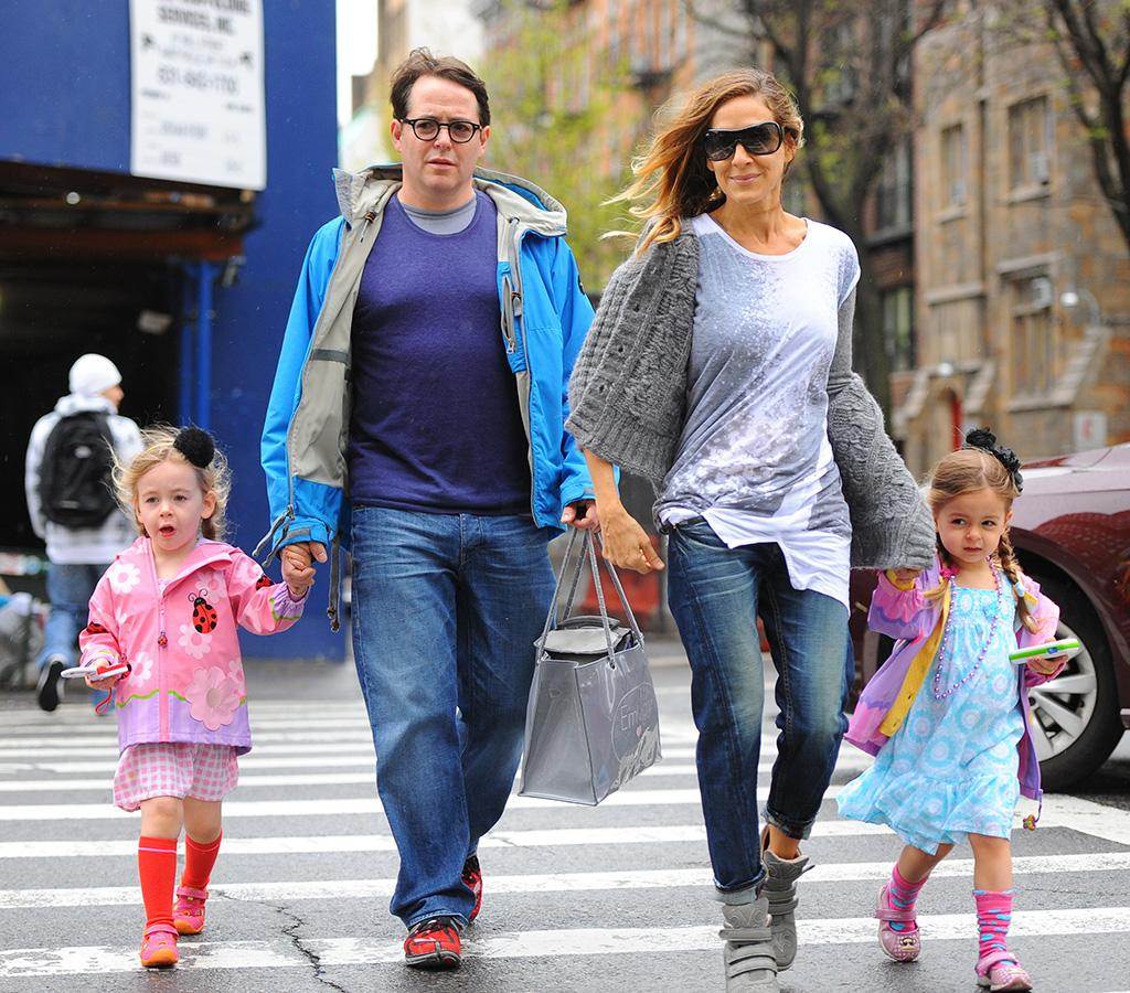 Sarah Jessica Parker may have recently just revealed she doesn't use a cell phone, but her daughters clearly don't take after her. Parker and hubby Matthew Broderick's ridiculously adorable twins, 3-year-old twins, Tabitha and Marion, each held on to a toy phone as they took a stroll witht their mom and dad in Manhattan on Monday. (4/29/2013)