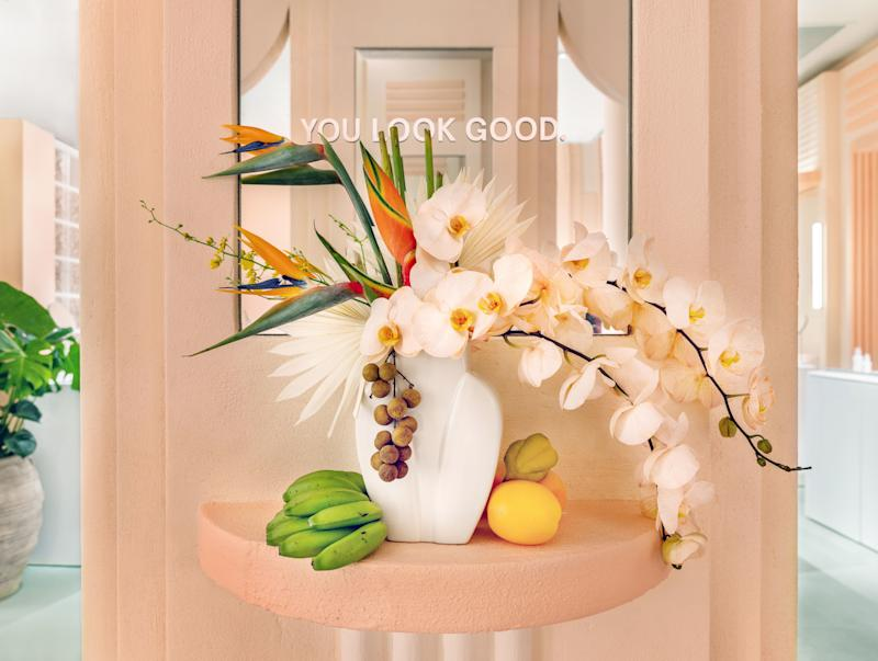 Baby bananas and birds of paradise mingle on an accent table.