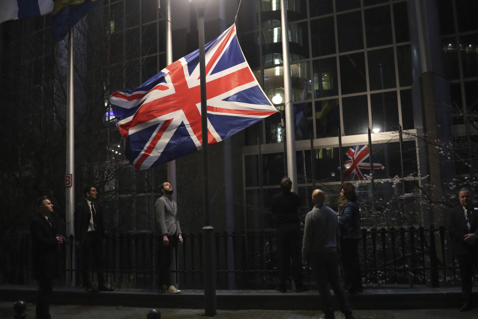 """FILE - In this Friday, Jan. 31, 2020 file photo, the Union flag is lowered and removed from outside of the European Parliament in Brussels. It's more than four years since Britain voted to leave the European Union, and almost a year since Prime Minister Boris Johnson won an election by vowing to """"get Brexit done."""" Spoiler alert: It is not done. As negotiators from the two sides hunker down for their final weeks of talks on an elusive trade agreement, Britain and the EU still don't know whether they will begin 2021 with an organized partnership or a messy rivalry.(AP Photo/Francisco Seco, File)"""