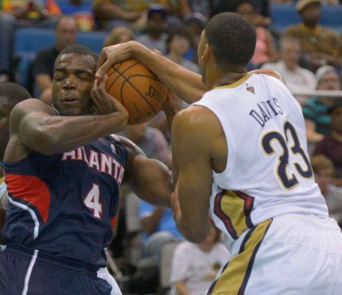 Advocate staff photo by MATTHEW HINTON-- Atlanta Hawks Paul Millsap (4) fights for control with New Orleans Pelicans Anthony Davis (23) in a NBA preseason basketball game between the New Orleans Pelicans and the Atlanta Hawks in Biloxi, Miss. Sunday, Oct. 13, 2013. (AP Photo/Matthew Hinton)