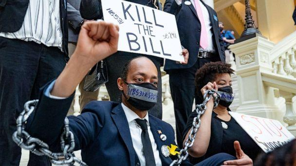 PHOTO: Demonstrators wear chains, March 8, 2021, while holding a sit-in inside of the Capitol building in Atlanta, in opposition of House Bill 531, one of the bills the GOP-led state legislature has been considering that would limit voting rights. (Megan Varner/Getty Images)