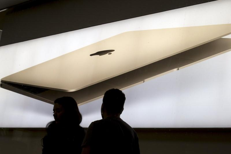 Employees work at the SoHo Apple Store in New York