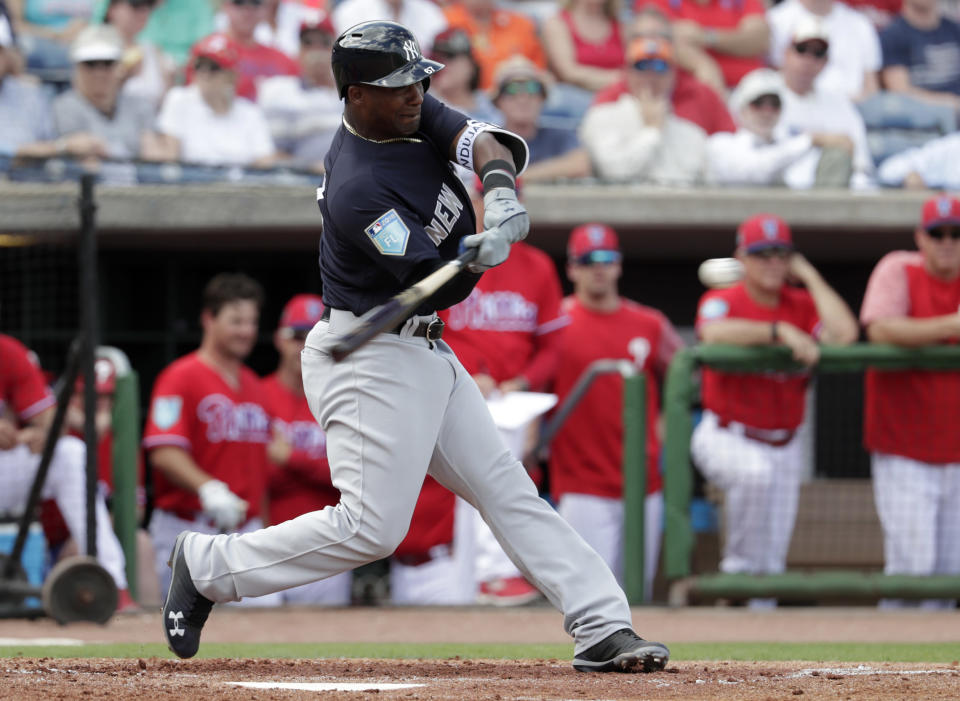 New York Yankees' Miguel Andujar hits a solo home run during the third inning of a baseball spring exhibition game against the Philadelphia Phillies, Thursday, March 1, 2018, in Clearwater, Fla. (AP Photo/Lynne Sladky)