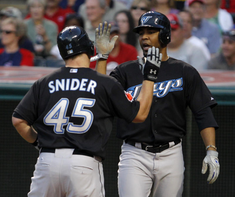 Toronto Blue Jays' Edwin Encarnacion, right, congratulates teammate Travis Snider after Snider drove him in with his  two-run home run against Cleveland Indians pitcher Mitch Talbot in the sixth inning of a baseball game in Cleveland on Friday, July 8, 2011.   (AP Photo/Amy Sancetta)