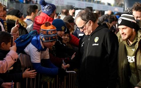 <span>Leeds manager Marcelo Bielsa signs autographs</span> <span>Credit: getty images </span>