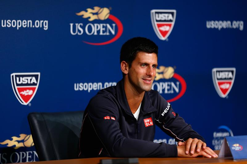 Novak Djokovic of Serbia talks to the media during previews for the US Open tennis at USTA Billie Jean King National Tennis Center on August 23, 2014 in New York City