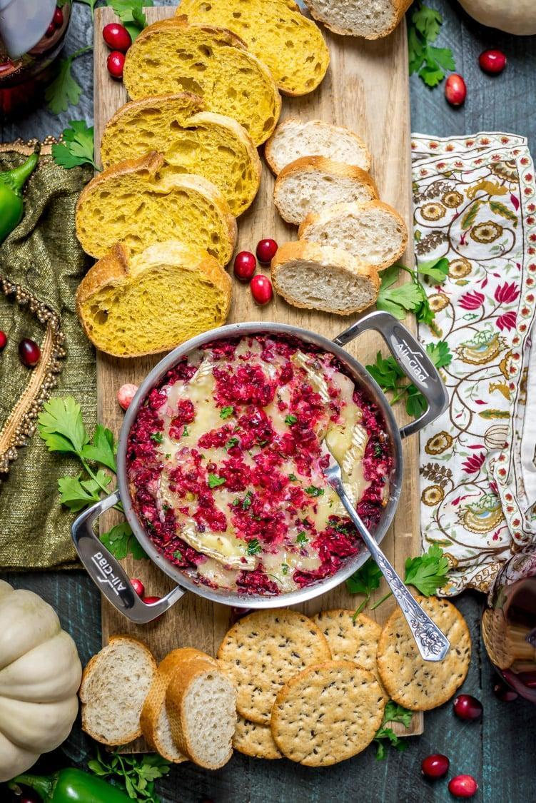 """<p>If you're into dips, you'll be all about this recipe! Tart, sweet, and a little spicy, this baked brie dip will be hard to walk away from. Notice how well the cranberries, jalapeños, and brown sugar work together to create a taste like no other.</p> <p><strong>Get the recipe</strong>: <a href=""""https://hostthetoast.com/cranberry-jalapeno-baked-brie-dip/"""" class=""""link rapid-noclick-resp"""" rel=""""nofollow noopener"""" target=""""_blank"""" data-ylk=""""slk:cranberry-jalapeño baked brie dip"""">cranberry-jalapeño baked brie dip</a> </p>"""