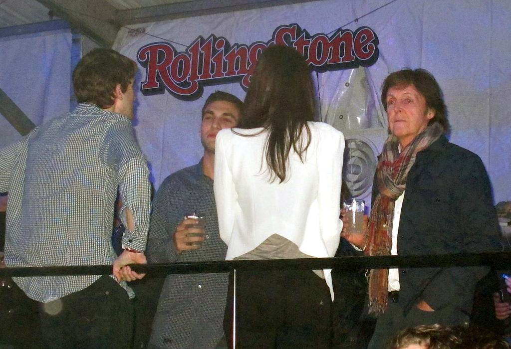 Paul McCartney and wife Nancy Shevell party with her son Arlen and dance to Nelly and other dance music while inside the utltra exclusive vip room at the Budwiser Hotel Superbowl party in New Orleans! The mega star was dancing to the beat and holding his wife close as fans took photos of him without a care in the world. They were in attendance to see Pitbull perform on stage at nearly 1am. Paul held a beverage in his hand and bopped to the different songs and he also waved to the fans below him. Nancy even talked to a fan wearing a New Orleans hat as she posed with Paul himself.