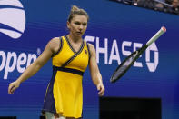 Simona Halep, of Romania, tosses her racket as she plays Elina Svitolina, of Ukraine, during the fourth round of the US Open tennis championships, Sunday, Sept. 5, 2021, in New York. (AP Photo/Seth Wenig)