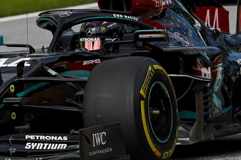 Back in black: Lewis Hamilton steers his car to the day's top time