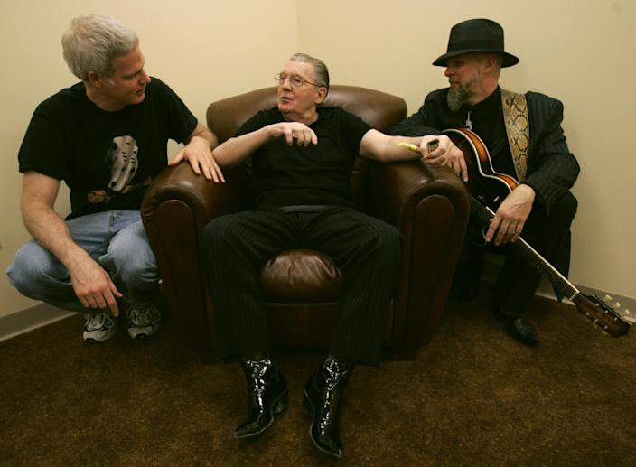 """Lee Lewis, center, is joined by Steve Bing, left, and Jimmy Rip, right, in Lewis' dressing room backstage at the San Manuel Indian Bingo and Casino in Highland, California May 19, 2005 prior to his performance. Bing and Rip were the driving force behind a new album with Lewis who was joined by a different rock legend on each track. <span class=""""copyright"""">(Mark Boster/Los Angeles Times)</span>"""