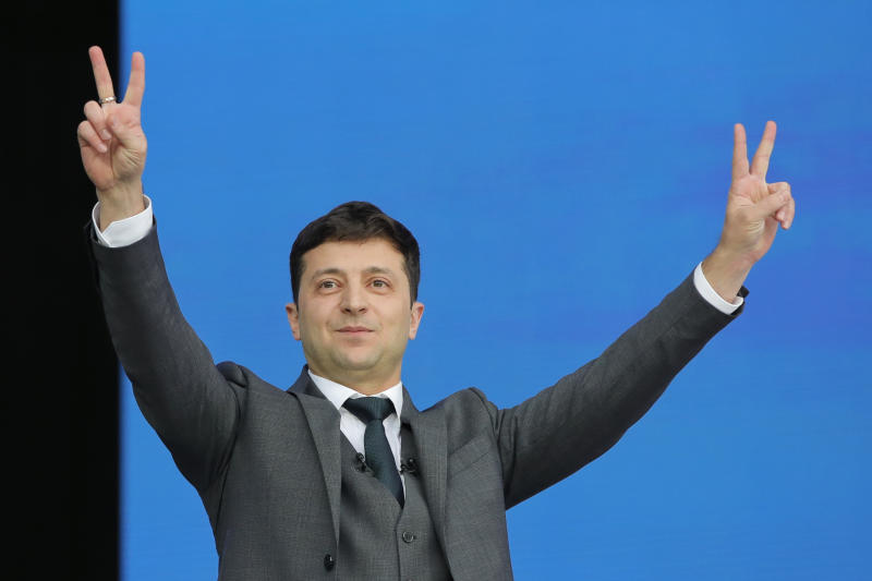 Ukrainian presidential candidate and popular comedian Volodymyr Zelenskiy makes the victory sign during the debate with Ukrainian President Petro Poroshenko at the Olympic stadium in Kiev, Ukraine, Friday, April 19, 2019. Friday is the last official day of election canvassing in Ukraine as all presidential candidates and their campaigns will be barred from campaigning on Saturday, the day before the vote. (AP Photo/Vadim Ghirda)