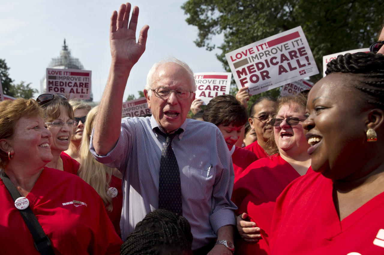 "<p> FILE - In this July 30, 2015 file photo, Democratic presidential candidate, Sen. Bernie Sanders, I-Vt., waves after speaking at a rally with registered nurses and other community leaders celebrate the 50th anniversary of Medicare and Medicaid, on Capitol Hill Washington. With the Obama administration counting down its final year, many Democrats are finding less to like about the president's health care law, unsure about its place among their party's achievements. Sanders' call for ""Medicare for all"" seems to have rekindled aspirations for bigger changes beyond ""Obamacare."" That poses a challenge for Hillary Clinton, who's argued that the health care law is working and the nation needs to build on it, not start over. (AP Photo/Jacquelyn Martin, File) </p>"