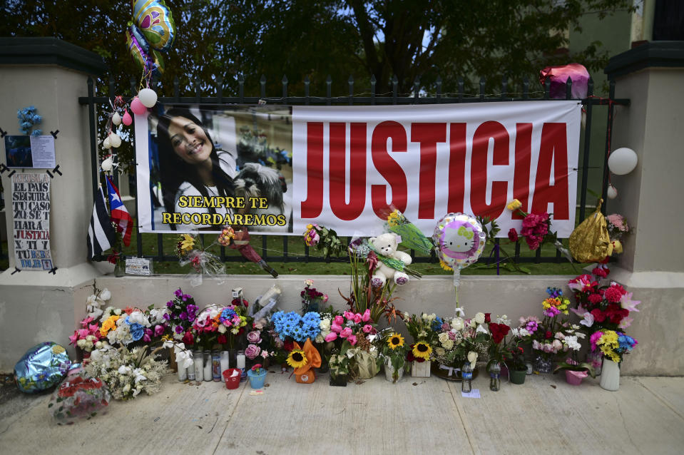 """Flowers, balloons and a poster with the Spanish word for """"justice"""" is part of a growing makeshift memorial for Keishla Rodriguez whose lifeless body was found in a lagoon Saturday, at the entrance of where she lived in San Juan, Puerto Rico, Thursday, May 6, 2021. A federal judge on Monday ordered Puerto Rican boxer Felix Verdejo held without bail after he was charged with the death of Keishla Rodriguez and with intentionally killing the unborn child she was carrying. (AP Photo/Carlos Giusti)"""