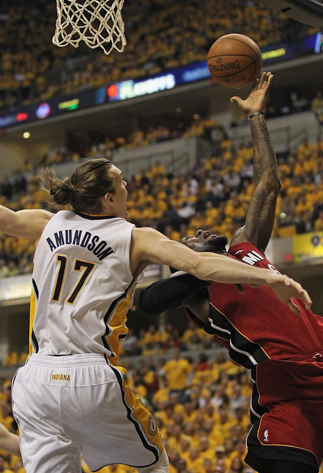 INDIANAPOLIS, IN - MAY 17: LeBron James #6 of the Miami Heat tries to get off a shot against Lou Amundson #17 of the Indiana Pacers in Game Three of the Eastern Conference Semifinals in the 2012 NBA Playoffs at Bankers Life Fieldhouse on May 17, 2012 in Indianapolis, Indiana. NOTE TO USER: User expressly acknowledges and agrees that, by downloading and/or using this photograph, User is consenting to the terms and conditions of the Getty Images License Agreement. (Photo by Jonathan Daniel/Getty Images)
