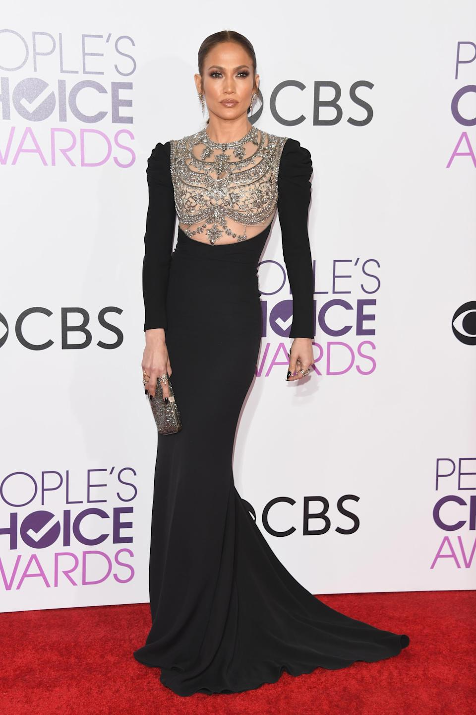 <p>The night J.Lo won her first People's Choice Award for her role in crime drama 'Shades of Blue.' The evening was especially memorable thanks to this bedazzled Reem Arca gown. [Photo: Getty] </p>