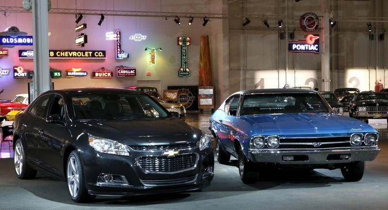 A 1969 Chevrolet Chevelle SS is seen next to a 2015 Malibu LTZ on display at the GM Heritage Center in Sterling Heights, Michigan