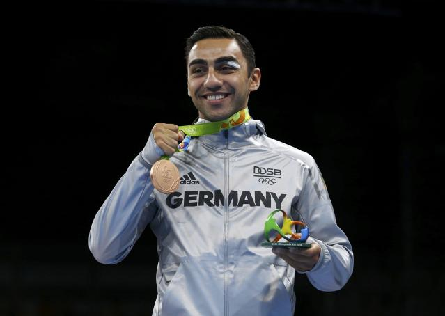 2016 Rio Olympics - Boxing - Victory Ceremony - Men's Light Welter (64kg) Victory Ceremony - Riocentro - Pavilion 6 - Rio de Janeiro, Brazil - 21/08/2016. Bronze medallist Artem Harutyunyan (GER) of Germany poses with his medal. REUTERS/Peter Cziborra FOR EDITORIAL USE ONLY. NOT FOR SALE FOR MARKETING OR ADVERTISING CAMPAIGNS.