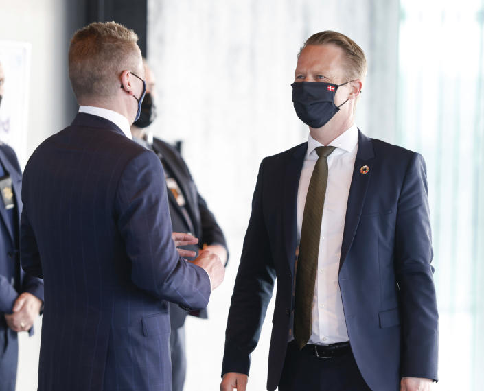 Danish Minister of Foreign Affairs Jeppe Kofod is greeted by Icelandic Minister of Foreign Affairs Gudlaugur Thor Thordarson as he arrives for the Arctic Council Ministerial Meeting in Reykjavik, Iceland, Thursday, May 20, 2021. (AP Photo/Brynjar Gunnarsson, Pool)