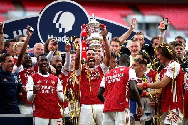 Pierre-Emerick Aubameyang scored twice to beat Chelsea before lifting the FA Cup.