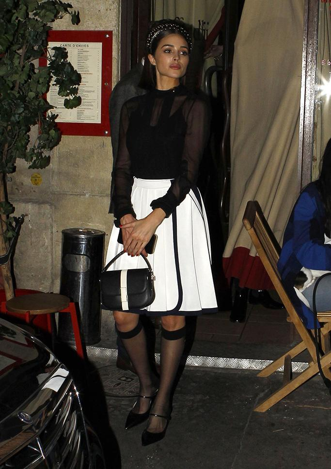 Olivia Culpo, ferdi restaurant, sheer socks, sheer blouse, white skirt, celebrity style, mary-janes Celebrities out and about, Paris Fashion Week, France - 27 Feb 2019