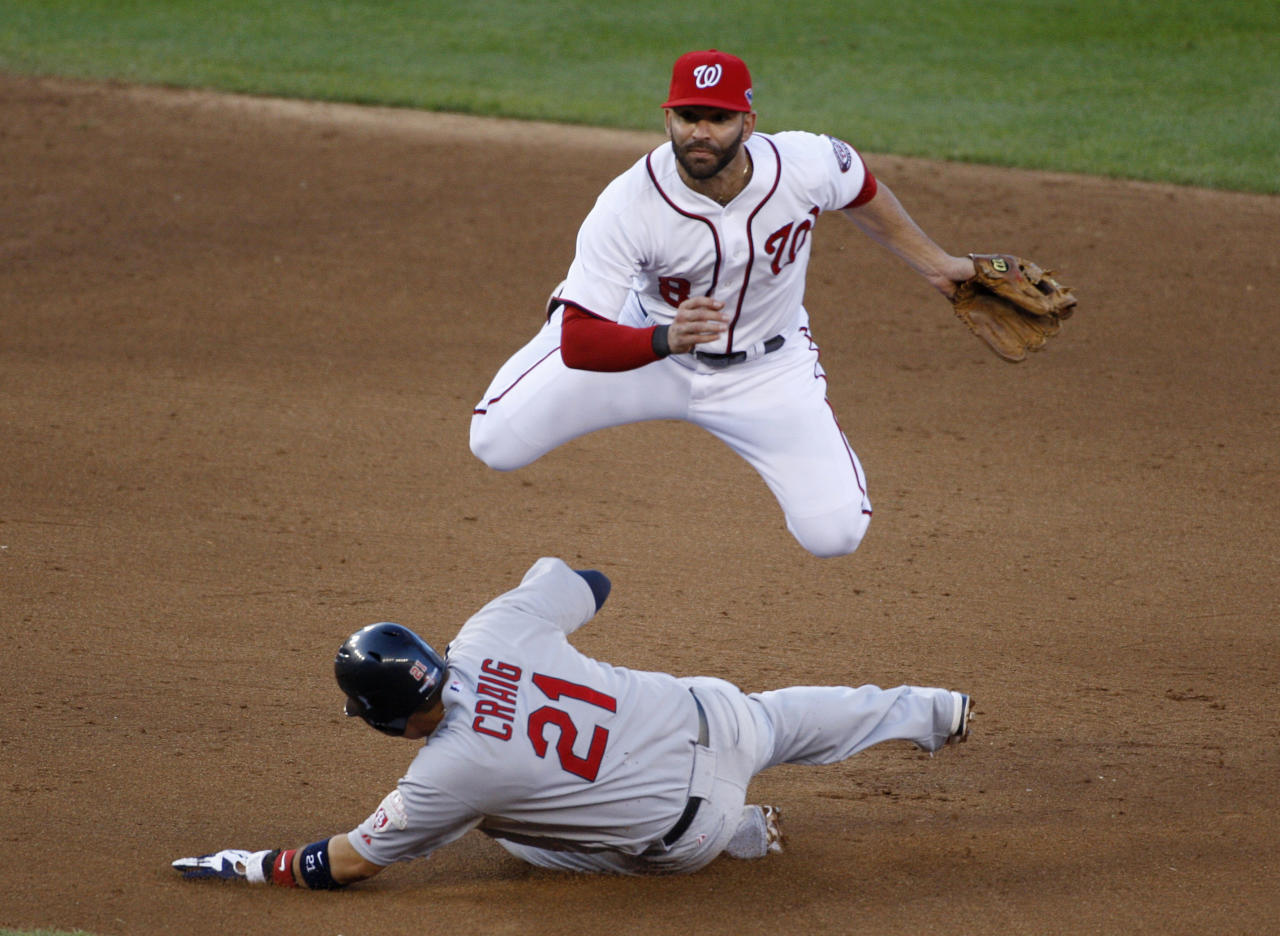 Washington Nationals second baseman Danny Espinosa tries for a double play as St. Louis Cardinals' Allen Craig (21) slides safely into second base during the sixth inning in Game 4 of their MLB NLDS baseball series in Washington October 11, 2012. REUTERS/Jonathan Ernst (UNITED STATES - Tags: SPORT BASEBALL TPX IMAGES OF THE DAY)