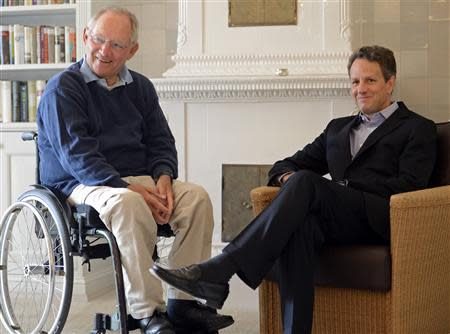 German Finance Minister Wolfgang Schaeuble (L) talks to his U.S. counterpart Timothy Geithner in Westerland on the German island of Sylt in this July 30, 2012 file picture. Reuters/Fabian Bimmer
