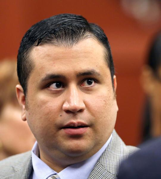 George Zimmerman talks to his attorney Mark O'Mara during a recess in Seminole circuit court in Sanford, Fla., Monday, June 17, 2013. Zimmerman has been charged with second-degree murder for the 2012 shooting death of Trayvon Martin.(AP Photo/Orlando Sentinel, Joe Burbank, Pool)