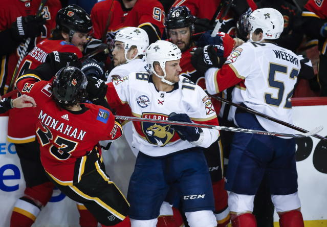 Florida Panthers' Micheal Haley, center, is caught in the fray with Calgary Flames' players during second-period NHL hockey game action in Calgary, Alberta, Friday, Jan. 11, 2019. (Jeff McIntosh/The Canadian Press via AP)