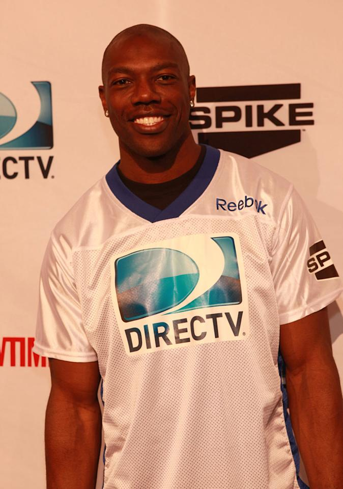 Former NFL star Terrell Owens arrives at the DirecTV Celebrity Beach Bowl in Indianapolis.