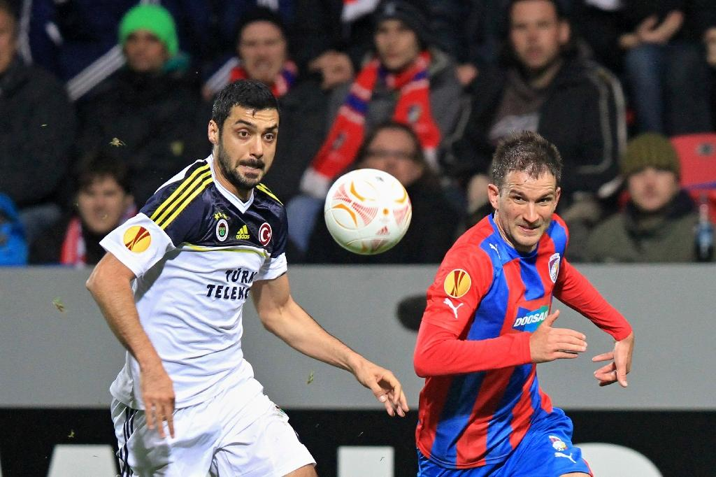 Bekir Irtegun (L), seen here playing for Fenebahce in 2013, is one of several present and former footballers to be detained in the wake of Turkey's failed coup (AFP Photo/RADEK MICA)