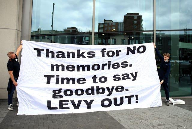 Fans stage a protest outside of the Tottenham Hotspur Stadium