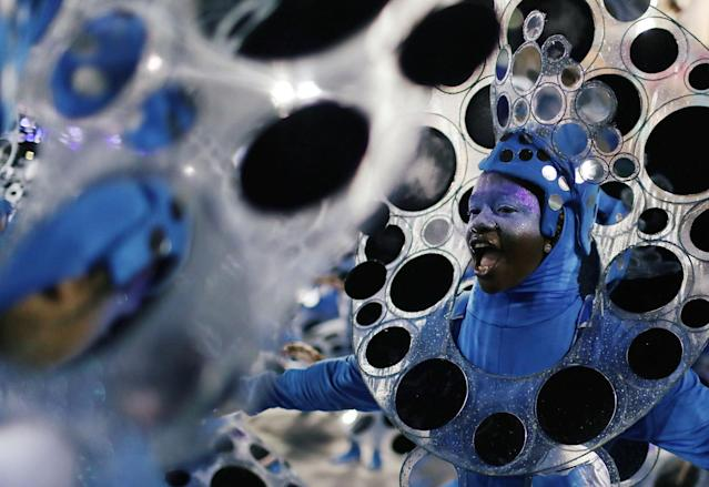 <p>Revellers from Portela Samba school perform during the second night of the Carnival parade at the Sambadrome in Rio de Janeiro, Brazil, Feb. 12, 2018. (Photo: Pilar Olivares/Reuters) </p>