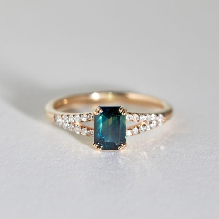 """<p>Opt away from the traditional diamond and instead choose a bright gemstone to feature on the band. This striking <a href=""""https://www.popsugar.com/buy/Eternal-Ring-531774?p_name=Eternal%20Ring&retailer=catbirdnyc.com&pid=531774&price=3%2C200&evar1=fab%3Aus&evar9=47015200&evar98=https%3A%2F%2Fwww.popsugar.com%2Ffashion%2Fphoto-gallery%2F47015200%2Fimage%2F47015980%2FRectangle-Cuts-Eternal-Ring&list1=shopping%2Cjewelry%2Crings%2Cengagement%20rings&prop13=mobile&pdata=1"""" rel=""""nofollow noopener"""" class=""""link rapid-noclick-resp"""" target=""""_blank"""" data-ylk=""""slk:Eternal Ring"""">Eternal Ring</a> ($3,200) makes the rectangle cut so noticeable with its sapphire center stone.</p>"""