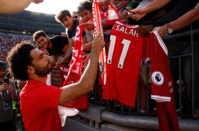 Mohamed Salah signs autographs after Liverpool's 4-1 preseason win over Manchester United in the International Champions Cup. (Getty)