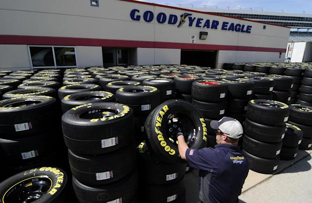 Brayden Wienke stacks tires at Texas Motor Speedway in Fort Worth, Texas, Friday, April 4, 2014. NASCAR will not regulate tire pressures at the speedway, and if drivers have tire failures during Sunday's race officials believe they will not be able to blame Goodyear. (AP Photo/Ralph Lauer)