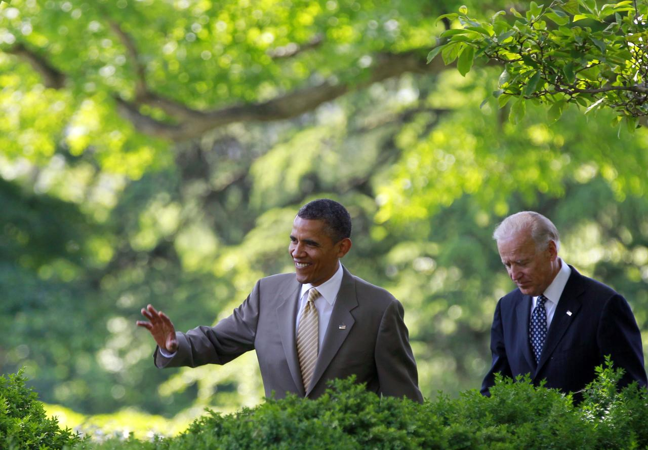 President Barack Obama and Vice President Joe Biden walk towards the Rose Garden of the White House for the ceremony honoring the 2012 National Association of Police Organizations TOP COPS award winners, Saturday, May 12, 2012, in Washington. (AP Photo/Haraz N. Ghanbari)