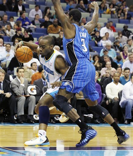 New Orleans Hornets power forward Carl Landry (24) tries to get around Orlando Magic forward Earl Clark (3) in the first half of an NBA basketball game in New Orleans, Friday, Jan. 27, 2012. (AP Photo/Bill Haber)