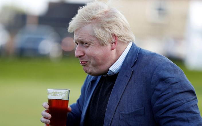 The Prime Minister, pictured drinking a beer in 2016, is making plans to cut obesity a priority - Phil Noble/Reuters