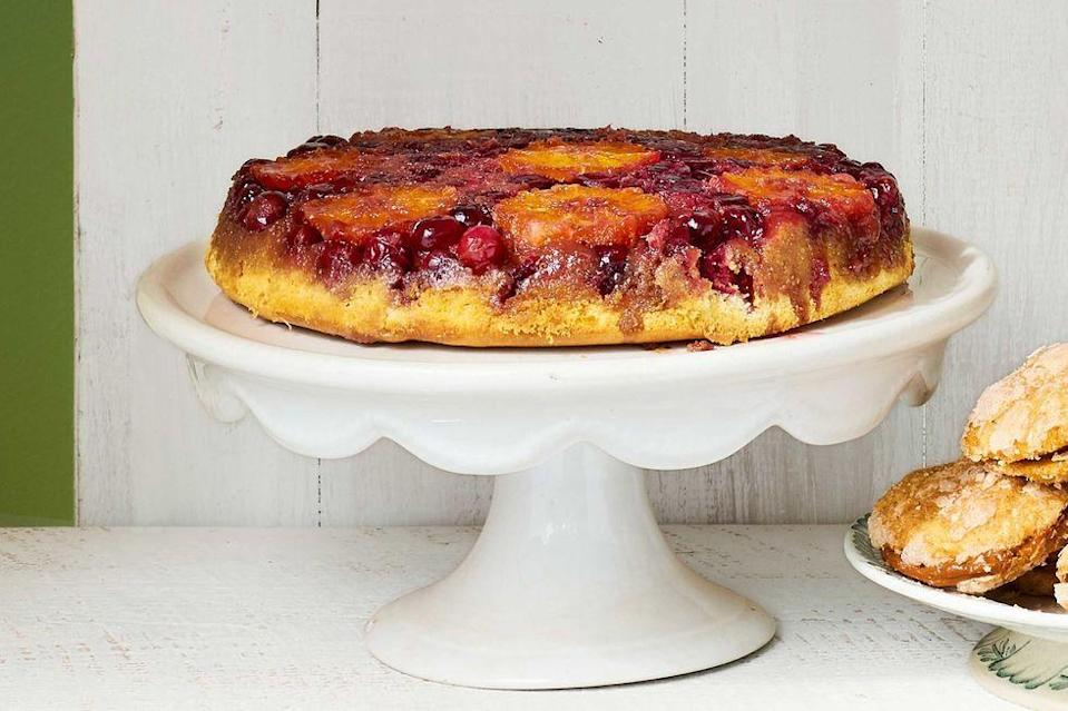 "<p>Juicy oranges and cranberries, spiced with fresh ginger, make a syrup-soaked centerpiece that's perfect for the season.</p><p><em><a href=""https://www.countryliving.com/food-drinks/recipes/a40040/upside-down-orange-cranberry-cake-recipe/"" rel=""nofollow noopener"" target=""_blank"" data-ylk=""slk:Get the recipe from Country Living »"" class=""link rapid-noclick-resp"">Get the recipe from Country Living »</a></em></p><p><strong>RELATED:</strong> <a href=""https://www.goodhousekeeping.com/holidays/thanksgiving-ideas/g1532/thanksgiving-desserts/"" rel=""nofollow noopener"" target=""_blank"" data-ylk=""slk:84 Absolutely Incredible Thanksgiving Desserts You Need to Make"" class=""link rapid-noclick-resp"">84 Absolutely Incredible Thanksgiving Desserts You Need to Make</a></p>"