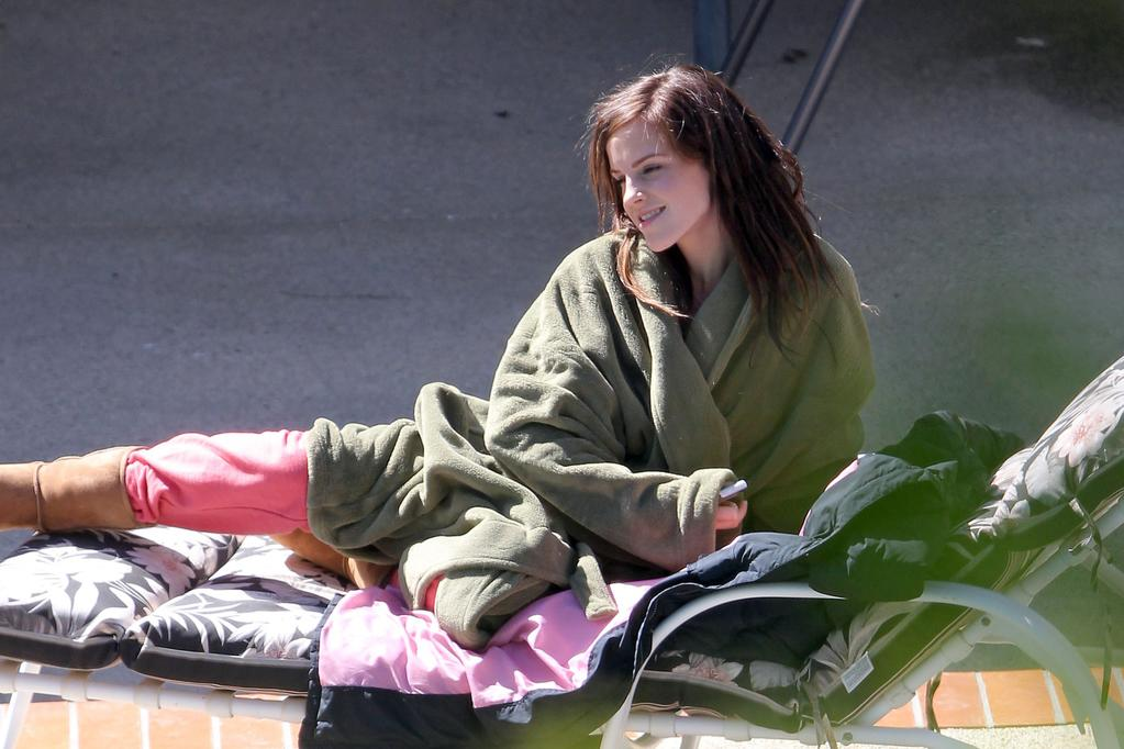 "Emma Watson lounging in the sun during a break in shooting <a href=""http://movies.yahoo.com/blogs/movie-talk/emma-watson-gets-bad-girl-makeover-bling-ring-172557442.html"">her upcoming film ""The Bling Ring.""</a>"
